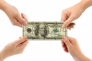 hands-pulling-dollar-bill-puzzle