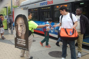 Street teams hand out safety materials to Metrobus riders